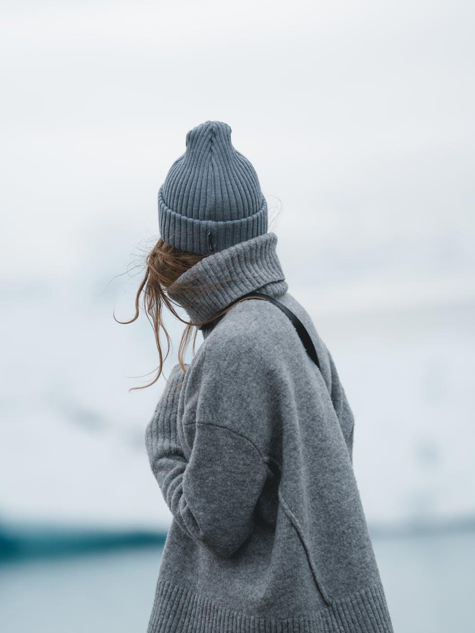 woman in grey jacket
